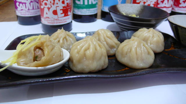 Beer xiao long bao serving